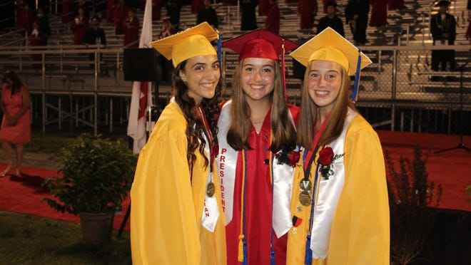 Dansville Class of 2020 valedictorian Madeline Shafer, class president Mary Catheirne Aikin and salutatorian Jasmyn Fox celebrate graduation Friday.