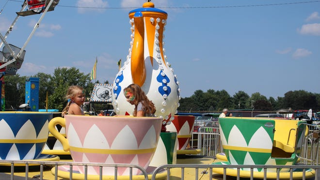 Emma Simmons and Alex Fromm take a spin on the teacup ride at the West End Fair on Friday, Aug. 24, 2018. This year's fair was canceled.