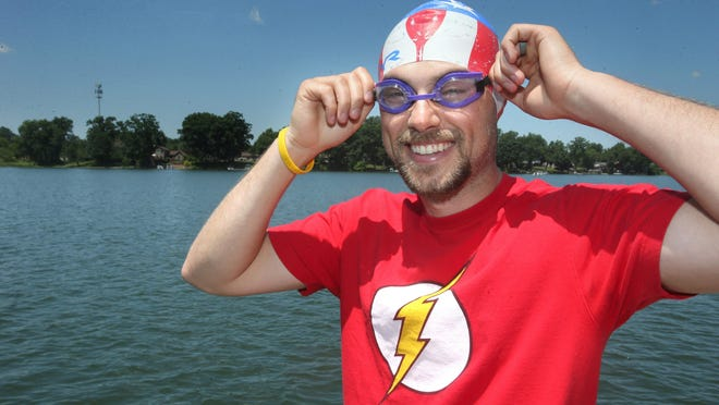 Derek Gordon is shown at Meyers Lake on Tuesday, June 30, 2020. On July 4th, Derek is swimming across the lake to raise money for NAACP of Stark County and Covid-19 fund of United Way of Greater Stark County. He is taking pledges for his swim.
