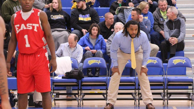 Coventry basketball coach Devon McAfee looks on during a game against Akron East in 2020.