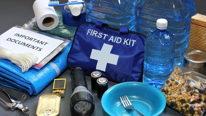 "A first-aid kit, flashlight, important papers and bottled water are among the items that should be in your ""go bag"" for disaster preparedness."