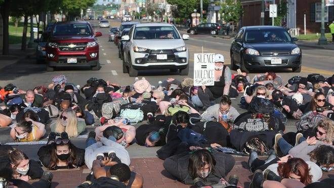Protesters block traffic on Tuscarawas Street West following the Stark County Peace Rally for Justice in Canton on Monday, June 1, 2020.
