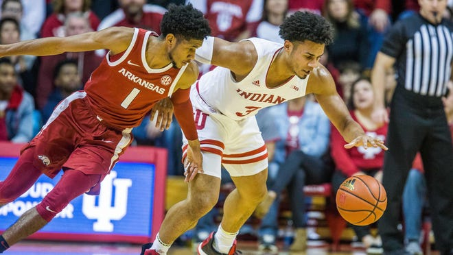Arkansas Razorbacks guard Isaiah Joe (1) and Indiana Hoosiers forward Justin Smith (3) go for a loose ball in the second half Dec 29, 2019, in Bloomington, Ind.