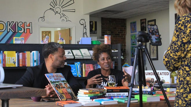 "64.6 Downtown Director Talicia Richardson, right, speaks alongside her husband AR District 78 state Rep. Jay Richardson during the event ""Let's Talk About Race"" on Wednesday, June 3, 2020, at Bookish bookstore in downtown Fort Smith."