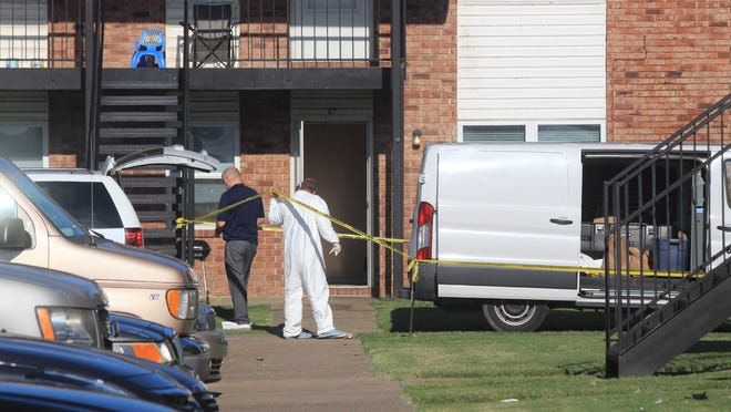Fort Smith police detectives investigate a shooting on Tuesday, Aug. 4, 2020, at West Apartments.