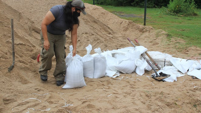 Nora Marin of Fort Smith fills sand bags on Thursday, Aug. 9, 2020, at 3900 Kelley Highway in Fort Smith. The sand supply and bags were provided in preparation for Hurricane Laura.