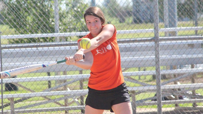 Kirksville's Haley McCarty swings at a pitch during Friday's workout for the softball team.