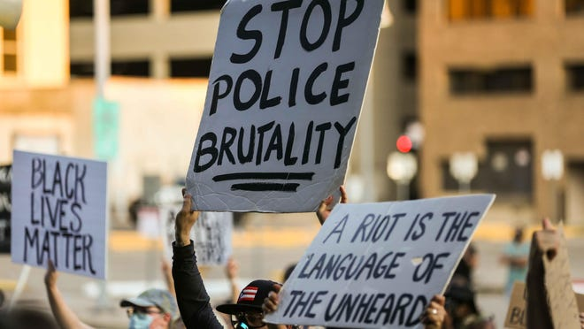 A group of protesters gather June 2 in downtown Austin to decry the death of George Floyd and police brutality against black Americans.