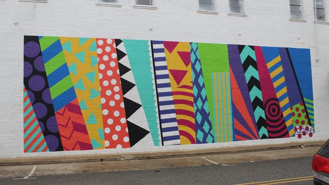 A colorful mural appears on a building in downtown Durant as part of the Magnolia Mile Art Alley. A competition featuring the works of mural artists will be held Friday in conjunction with Durant Main Street's First Friday event.
