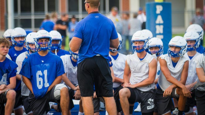 Van Alstyne High School coach Mikeal Miller addresses his team on the first day of practice Aug. 3.