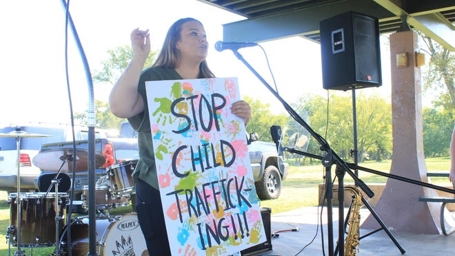 Event organizer Tonya Carruth speaks at a Save Our Children rally on Saturday, Aug. 22, 2020, at Ben Geren Park in Fort Smith.