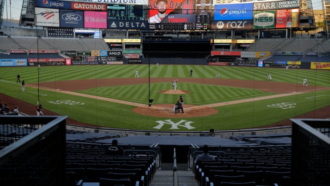 The stadium is almost totally empty during the second inning of a baseball game between the New York Yankees and the Boston Red Sox at Yankee Stadium, Friday, July 31, 2020, in New York.