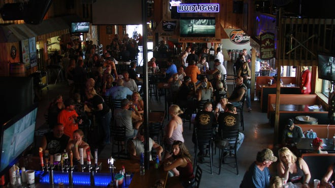 People fill a bar during the Sturgis Motorcycle Rally on Aug. 7, 2020, in Sturgis, S.D., amid the coronavirus pandemic.