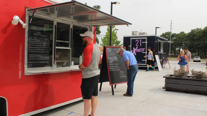 Josh Funmaker of Bentonville orders from Big Tasty Burger food truck on Saturday, June 27, 2020, at The Bakery district in downtown Fort Smith.