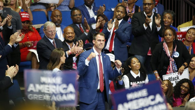 FILE - In this June 20, 2020 file photo, Oklahoma Gov. Kevin Stitt is recognized as President Donald Trump speaks during a campaign rally at the BOK Center in Tulsa, Okla. Oklahoma's former state epidemiologist warned as many as nine deaths and 228 new cases of coronavirus could result from President Donald Trump's June rally in Tulsa, according to documents released Wednesday, Sept. 16, 2020, by the Oklahoma State Department of Health show.