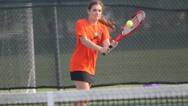 Kirksville's Maren Elmore returns a serve during a double match against Trenton on Thursday.