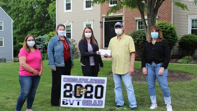Representing BVT's culinary arts alumni, from left to right, are Dawn Dubois (1982), Kathleen Manoogian (1998), Keith Bonetti (1990), and Cheryl Moore (1990), presenting the check to Olivia Corey in the middle of the group (2020) outside her home in Millbury.