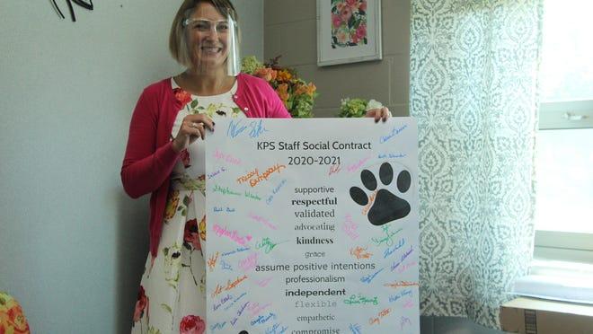 Kirksville Primary School Principal Diana Johnson holds up the social contract signed by staff members at the school. It is a new facet at the school created by the Capturing Kids' Hearts program.