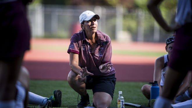 Newton head field hockey coach Lisa Bechtel meets with her team during halftime of a game against Hackettstown on Sept. 4, 2019, at Newton High School.