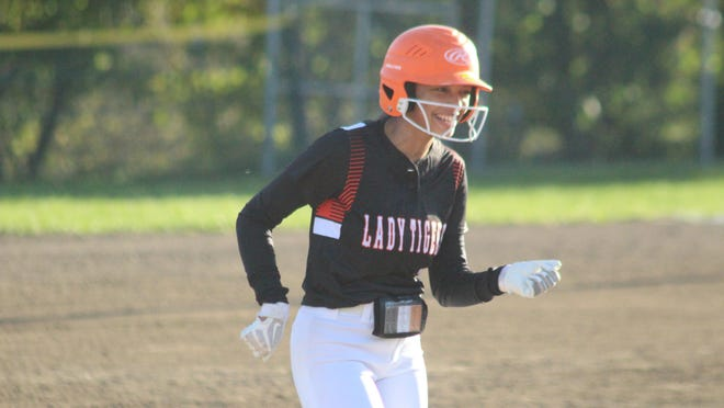Brashear's Kynleigh White smiles while rounding second base after a solo homer against Milan.