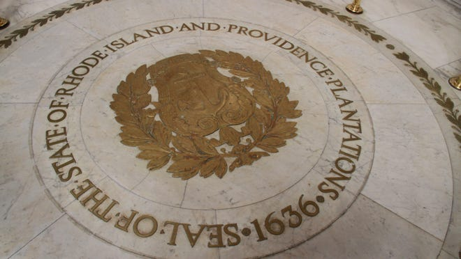 """A brass state seal is embedded in the marble floor of the State House rotunda, """"Seal of the State of Rhode Island and Providence Plantations."""