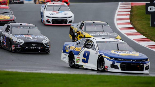 Chase Elliott (9) leads the way out of Turn 7 in a NASCAR Cup Series race Sunday at Charlotte.