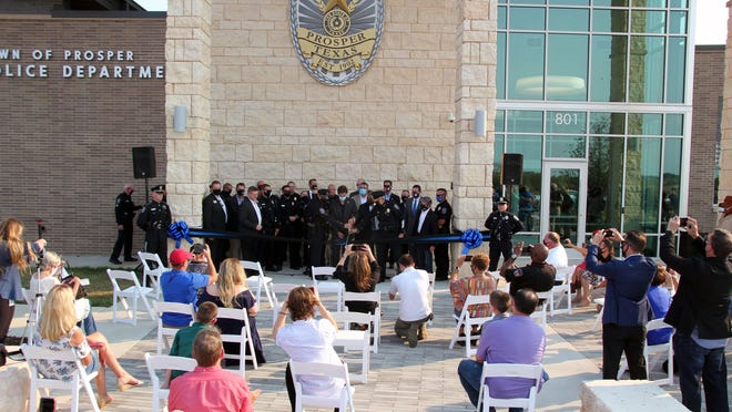 Local officials and residents gather Oct. 6 for a ribbon-cutting ceremony at the new Prosper Police Department headquarters building on Safety Way.