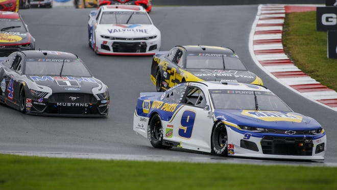 Chase Elliott leads the way in a race at Charlotte Motor Speedway in Concord, N.C., last Sunday.
