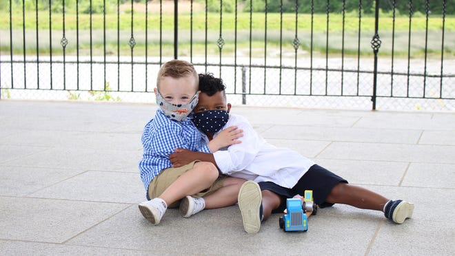 3-year-olds Landon Armata (left) and Vondell Cherry (right) became viral sensations after their mothers posted photos of their first play date in Swasey Parkway on social media.