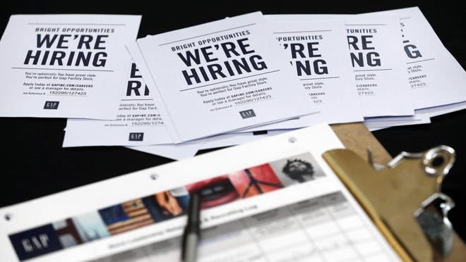 FILE - In this  Oct. 6, 2015, file photo, job applications and information for the Gap Factory Store sit on a table during a job fair at Dolphin Mall in Miami.