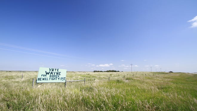 A sign for a tribal council candidate on the Rosebud Indian Reservation is shown on Aug. 6, 2020. An Associated Press analysis in Democratic primaries in South Dakota showed that turnout was 10% lower among voters who lived in counties with a majority American Indian population and at least 95% of the county on reservation land. Voter advocates say that long trips to access polling places and the fact that some people lack reliable transportation has led to low voter turnout.