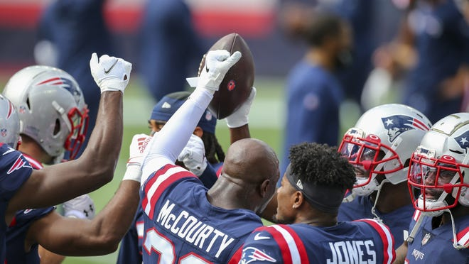 New England Patriots defensive players huddle up prior to an NFL football game against the Las Vegas Raiders Sunday in Foxborough.