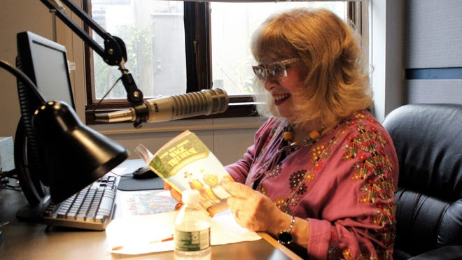 In a November, 2019 photo, Talking Information Center volunteer Carol Friedman of Hingham reads children's books outloud for those who are vision-impaired. Audrey Cooney/Wicked Local photo.