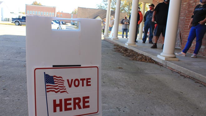Voters line the walkway up to the front door of First Baptist Church in Sallisaw to vote on Election Day, Tuesday, Nov. 3, 2020.