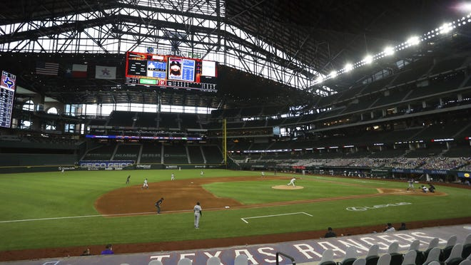 The Colorado Rockies and the Texas Rangers play in a baseball game at the new Globe Life Field Saturday, July 25, 2020 in Arlington, Texas.