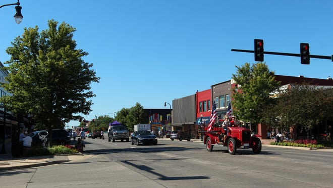 The annual Emancipation Day parade proceeds up Hutchinson's Main Street on Saturday morning.