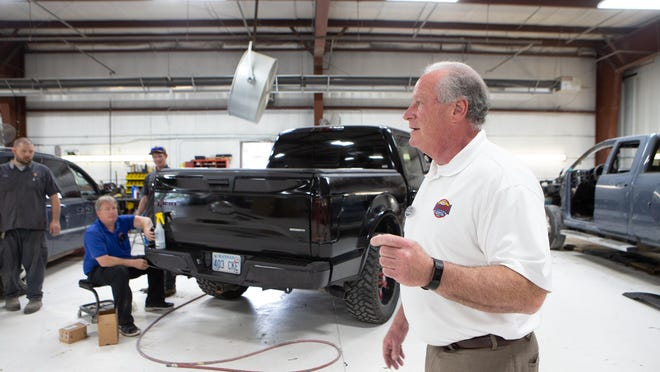 Chris Spargo, president of Ed Bozarth Chevrolet, walks through the various departments at his dealership.