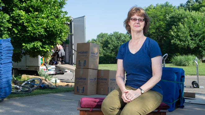 Rabbi Debbie Stiel sits on a bench as movers pack up her belongings Thursday morning in her house in Topeka. For the past 14 years, Stiel has been the rabbi for Topeka's Temple Beth Sholom.