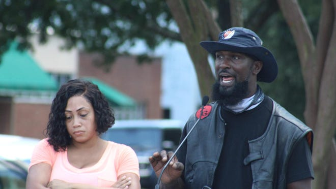 King Me Motorcycle Club member Lionel Jefferson (right) speaks to the crowd at the Juneteenth march in Downtown Aiken, S.C. on Saturday.