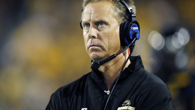 Southern Mississippi football coach Todd Monken watches his team play Mississippi State during the second half of an NCAA college football game at M.M. Roberts Stadium in Hattiesburg Miss., Saturday, Sept. 5, 2015. Mississippi State won 34-16.