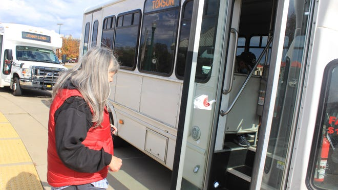 Karen Borger boards a Fort Smith transit bus on Thursday, Nov. 12, 2020. Public transit is an area the United States government uses census data to fund.