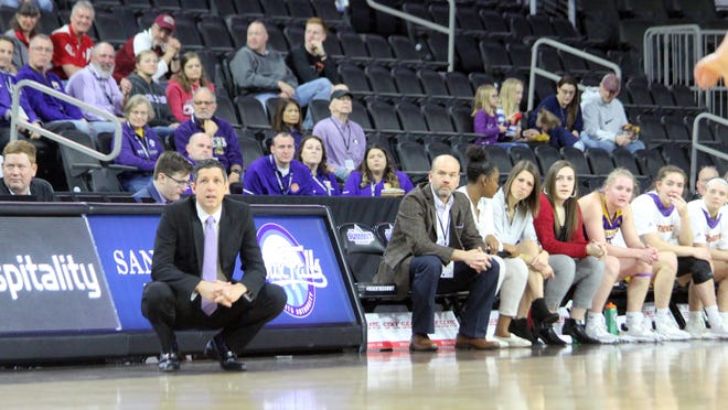 The Western Illinois women's basketball team watches a game during the Summit League Tournament in Sioux Falls, South Dakota last March.