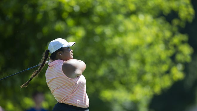 Defending champion Katelyn Sayyalinh, shown hitting a tee shot Sunday at Ingersoll, edged three-time former champ Melissa Dofflemyer 1 up in 19 holes in the Women's City quarterfinals.