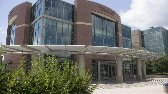 As many as 10 employees of the Winnebago County Sheriff's Department are not working after testing positive for COVID-19, the respiratory illness caused by the coronavirus.