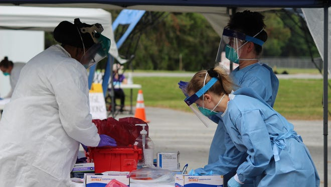Individuals from the Chatham County Health Department and Mercer University work at one of Chatham County's COVID-19 testing sites.