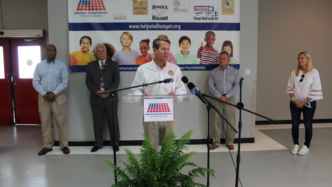 Georgia Governor Brian Kemp speaks after touring the America's Second Harvest food bank in Savannah on June 3. Also pictured, from left: Georgia State Senator Lester Jackson, Georgia House Representative Ron Stephens, U.S. Representative Buddy Carter, and Georgia First Lady Marty Kemp.