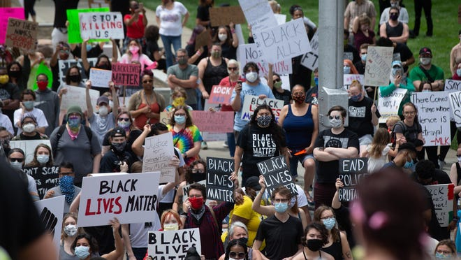 Protesters take part in a Black Lives Matter rally held in May at the Kansas Statehouse.