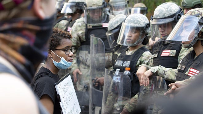 Demonstrators protest in front of a military police line near the White House on June 3.