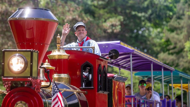 Shane McCoy conducts the Iron Horse miniature train at Gage Park as it departs the station Tuesday afternoon. The train is open for rides from 10:30 a.m. to 5 p.m. Monday through Sunday.
