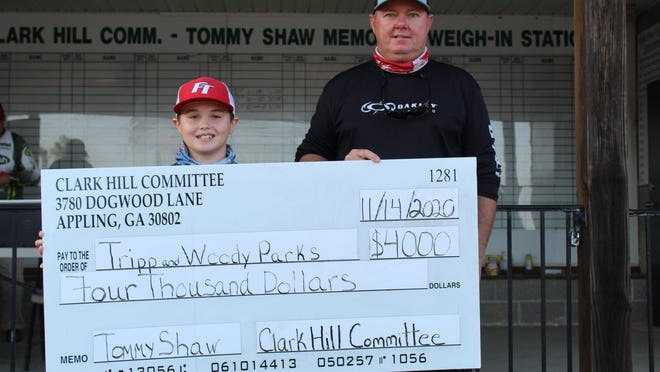 Woody Parks and his son, Tripp, 13,  show off the oversized Tommy Shaw Memorial winners' check.